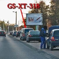 Ca 150 Meter nach der Bahnschiene, rechte Seite in der Parkbucht, zwischen Autos geparkt. Dort steht der graue VW Caddy Maxi (GS-XT-318). Stadteinwärts, Richtung Stadion. 50 kmh.